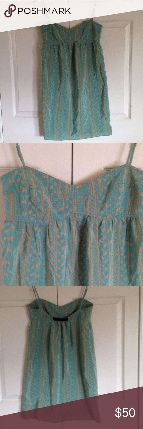 """Thomas Sires silk summer dress Size 8 Thomas Sires 100% silk turquoise and tan Aztec print dress. Size 8. Adjustable spaghetti straps and elastic at back for added comfort. Fitted chest with stitched detail. Empire waist. Overall length is 34"""" and chest measures 16 1/2"""" flat. Gently used. Excellent condition. Thomas Sires Dresses"""