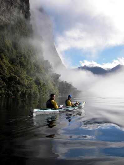 Kayak with dolphins in the heart of beautiful Fiordland National Park, where epic scenic shots were filmed for The Hobbit: An Unexpected Journey.