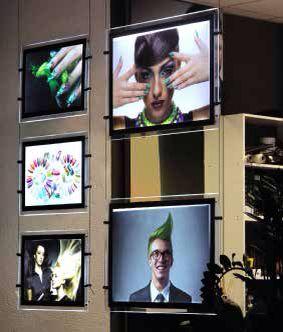 Window led display Bifacciale grafica intercambiabile espositori per vetrina  con pannelli luminosi  e cavi in acciaio