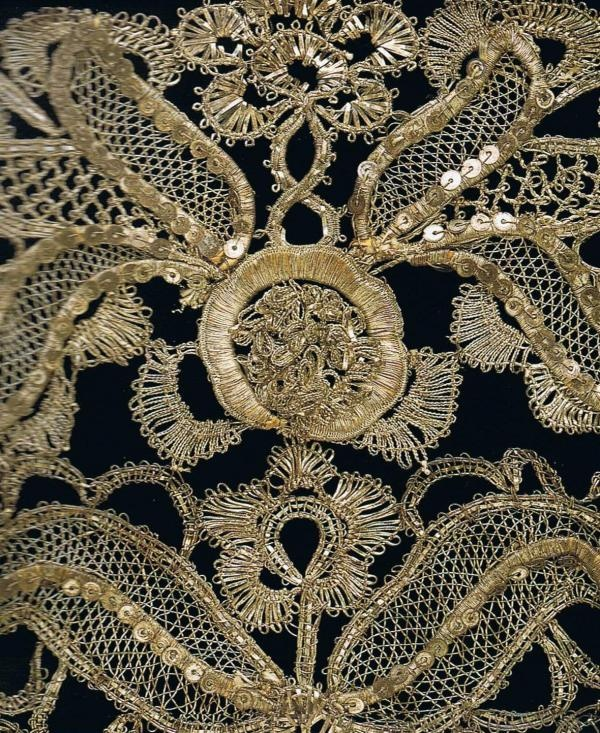 Silver-thread bobbin lace on c. 1740 stomacher…  Decorative V shaped panels that cover front of bodice…