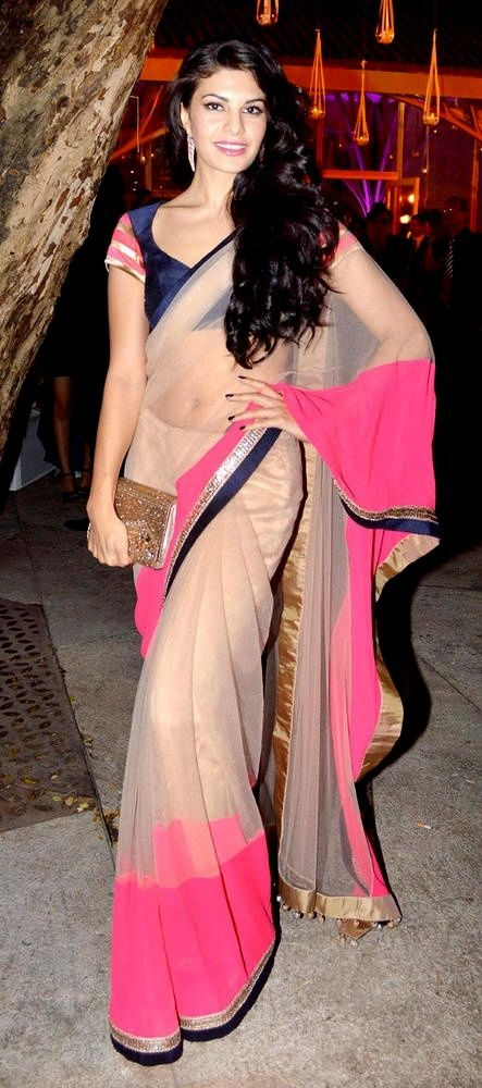 A nude net #sari with #neon pink chiffon and navy blue raw silk and gold #embroidered #border by #ManishMalhotra