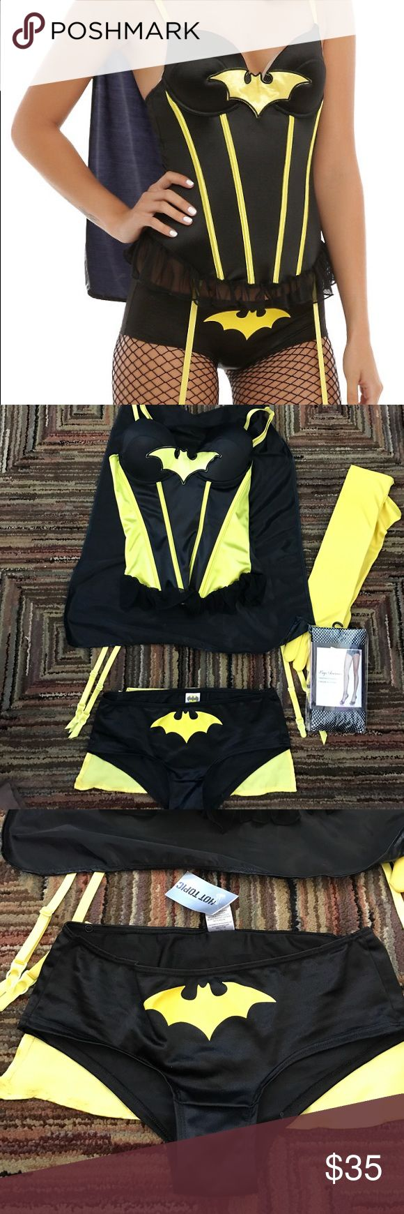 New sexy batman costume This is a super sexy Batman costume which includes a corset with a cape attached in a size medium boy shorts with a cape attached to the bottom of the boy shorts in a size small a set of gloves and leg avenue fishnet pantyhose Hot Topic Other