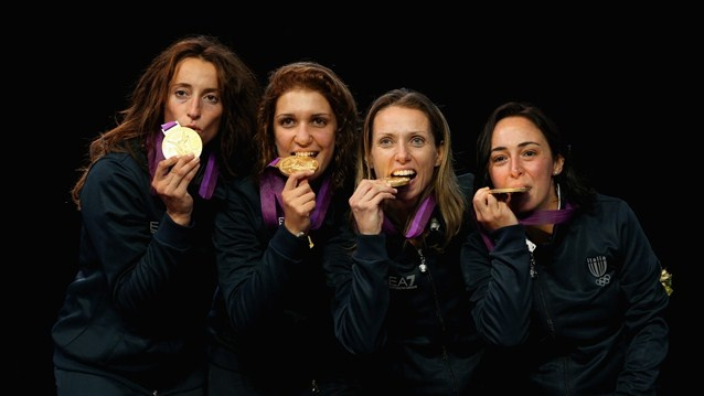 Italian women's Foil Team celebrate with their gold medals