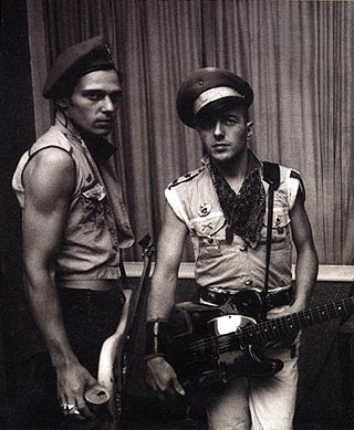 'THE CLASH' Paul Simonon and Joe Strummer AND THEIR 'COMBAT ROCK' PUNK MILITARY STYLE IN THE LATE 70S EARLY 80S HARD