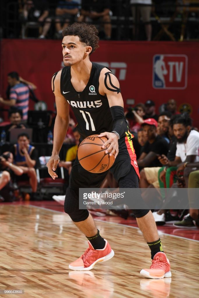 Trae Young Of The Atlanta Hawks Handles The Ball Against The