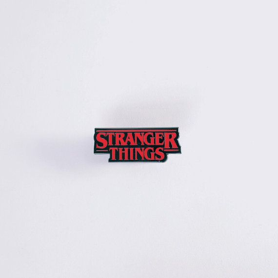 Netflixs amazing new series Stranger Things title graphic pin is here!! 1.25 inch (31.75mm) 1 Rubber back piece Black hard enamel Raised metal @nerdpins logo on back