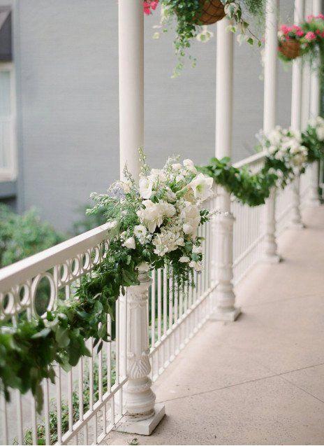Greenery wedding reception decor idea - greenery garland with white flowers {Pearl Events Austin}