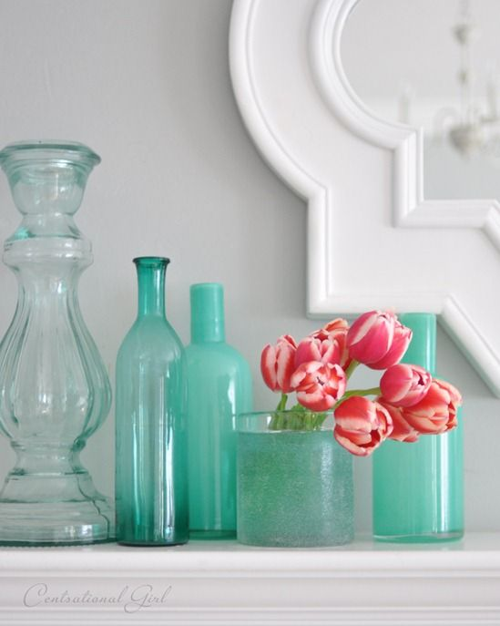coral tulips in blue vases--such a pretty color scheme. Maybe for the girls' room when we move.