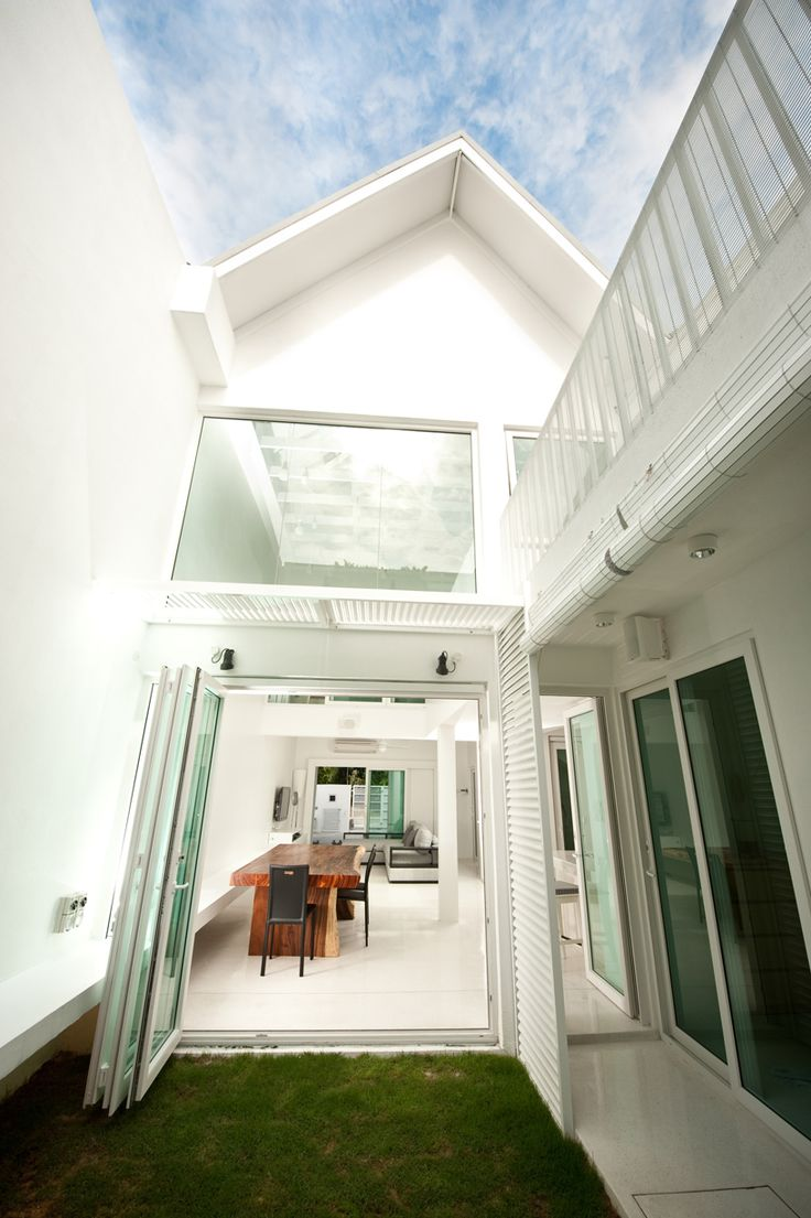Open Indoor Courtyard Creates A Private Open Space Within This Terrace House Amazing Design