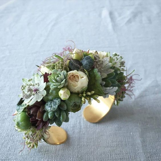 Succulent, astrantia, painted fern, spray rose & smoke bush gold cuff corsage.