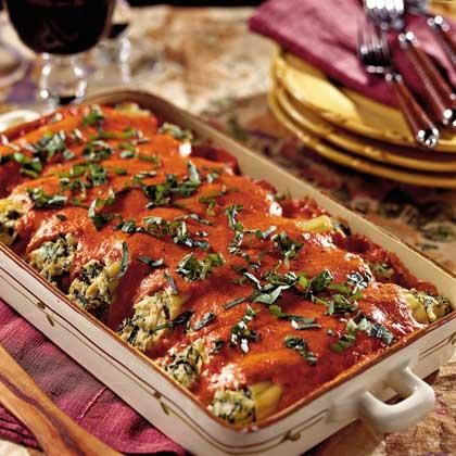 This classic Italian pasta dish features cannelloni or manicotti shells stuffed with a mixture of chicken, cheese and spinach and topped wtih roasted red pepper sauce.