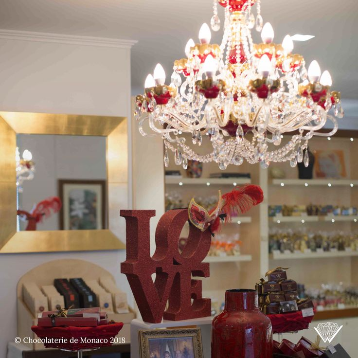 Our chandelier Amore hanging among all the Chocolaterie de Monaco goodies.