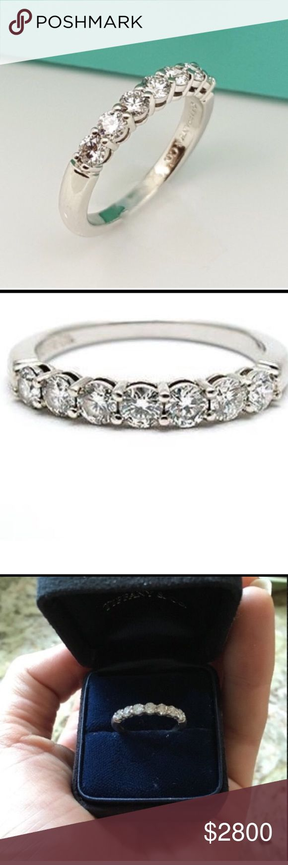 Tiffany and Co. platinum diamond engagement band Tiffany and Co shared setting band ring. Shared settings band ring with a half circle of round brilliant diamonds in platinum. 3mm wide. Estimate $6,000 value. The diamonds are loose and should be tightened. The 3rd diamond has a bit of wear and tear. This ring is absolutely stunning ! Size 6.25.      Negotiable through PP Tiffany & Co. Jewelry Rings