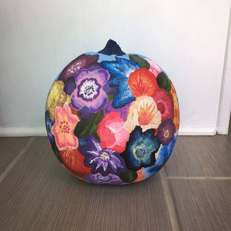 Colorful flowers painted pumpkin for halloween and fall Flower painted pumpkins
