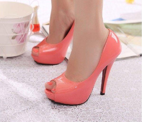 Stylish peep toe high heel pumps in watermelon red.