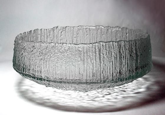 WIRKKALA, TAPIO Ultima Thule: Bowl 2332 Manufacturer: Iittala  Designed: 1968  In production: 1970  Diameter: 365 mm  Keskipakoisvalettua glass. Made with a diameter of 115, 165, 200 and 365 mm in width. Introduced in the Milan Triennale in 1968.  closed-blasted steel mold (originally in graphite), glass, polished edge. Wirkkala designed Ultima Thule Finnair's international flights made. Airline travelers rejoiced in series, and it was Iittala product range. Ultima Thule has been the most…