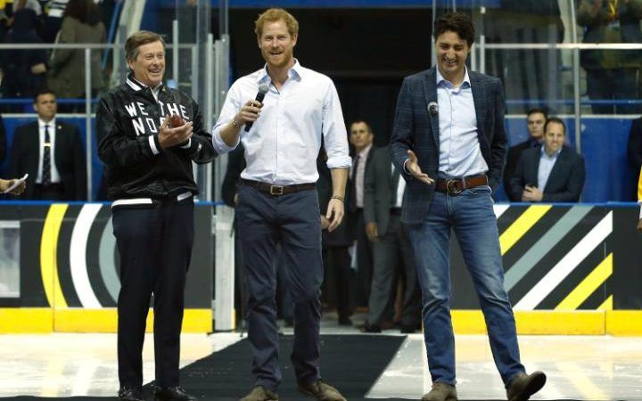 Prince Harry (centre) with Mr Trudeau (right) and Toronto mayor John Tory (left) at the Mattamy Centre during the Prince's visit to Toronto to promote the Invictus Games