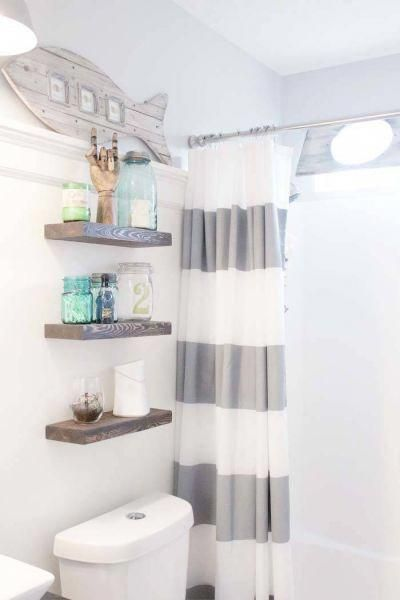 Grey nautical striped shower curtain. Rustic floating shelves above toilet.  Rep…   – bathroom shelves