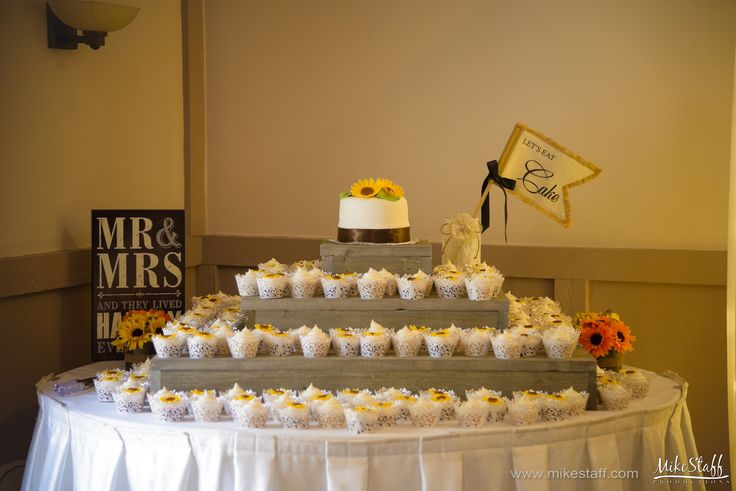 Sunflower wedding cake with layers of cupcakes #wedding #cake #Michiganwedding #Chicagowedding #MikeStaffProductions #wedding #reception #weddingphotography #weddingdj #weddingvideography #wedding #photos #wedding #pictures #ideas #planning #DJ #photography