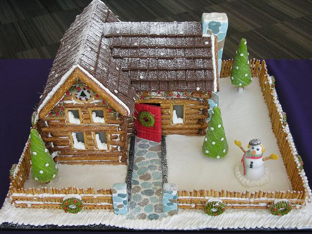 I like this pretzel log cabin done in a gingerbread house style.  The pretzel fence looks great!