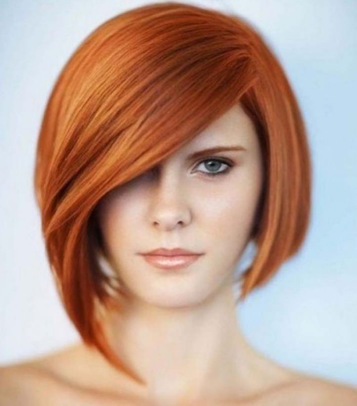 Graduated bob haircut with long bangs for round face