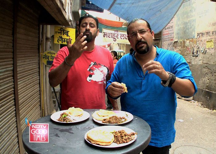At the famous chacche di hatti in North Campus, trying the chole bhature as they walk down memory lane