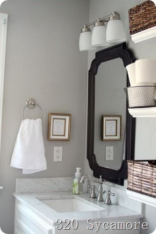 The wall paint color is Fossil Grey by Glidden master bathroom: details