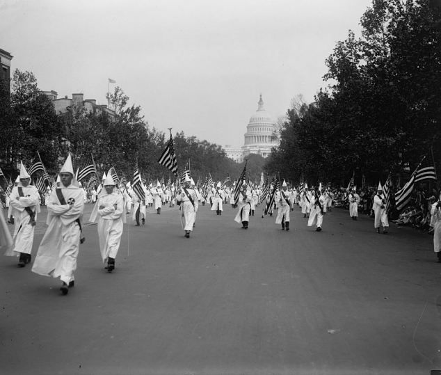 KU KLUX KLAN....Ghostly vision: More 50,000 of the Ku Klux Klan gathered in the shadow of the Capitol¿s dome for two parades in Washington DC in 1925 and 1926