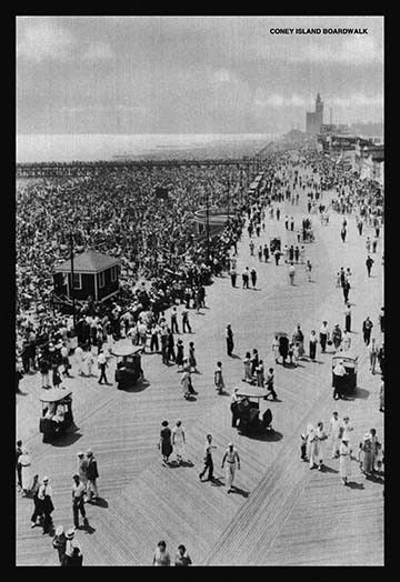 Throngs of revelers enjoy the beauty of the day on beach in New York City's top amusement park.