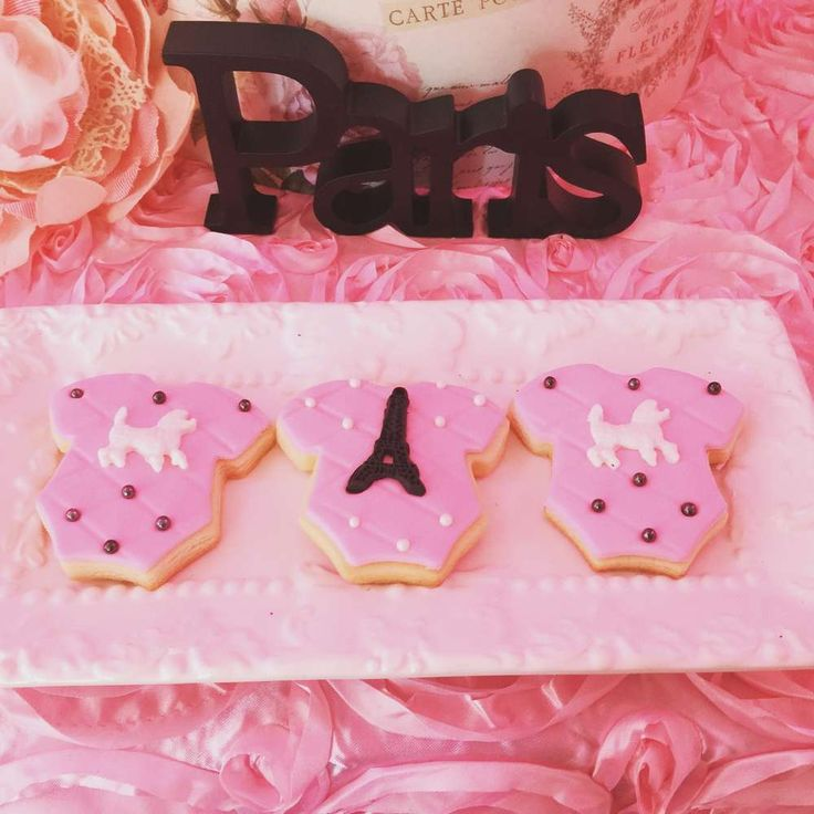 Cute onesie cookies at a Paris baby shower party! See more party ideas at CatchMyParty.com!