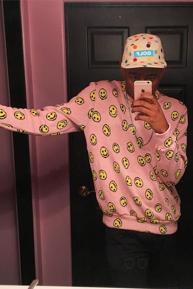 Tyler The Creator wearing  Golfwang Allover Happy Face Sweater, Golfwang FW15 Dot Camp Hat