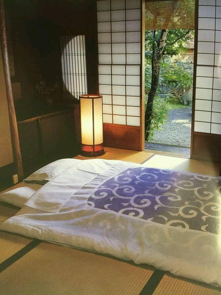 Japan Futon Bedding On Tatami Mat Floor With Open Shoji Screen