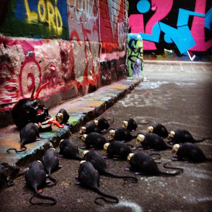 """""""Disciples....at the Feet of the Master"""" by SKOLLTOR. Skull street art installation - sculptural street install - casual street art expression."""