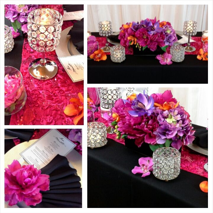table setting with rich purples, pinks, oranges and crystal candle holders; design by Davis Floral Creations