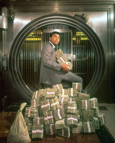 Muhammad Ali with his winnings in 1964.