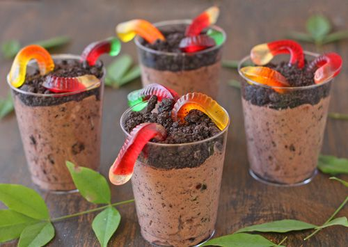 """Chocolate Instant pudding mixed with cool whip and crushed Oreos...sprinkle more crushed oreos ontop and stick gummy worms in """"dirt"""""""
