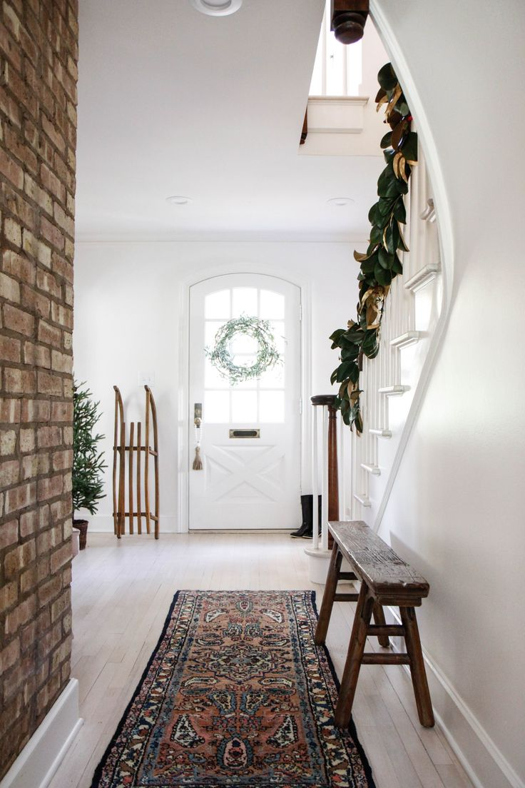 simple holiday decor in an entryway // anne sage