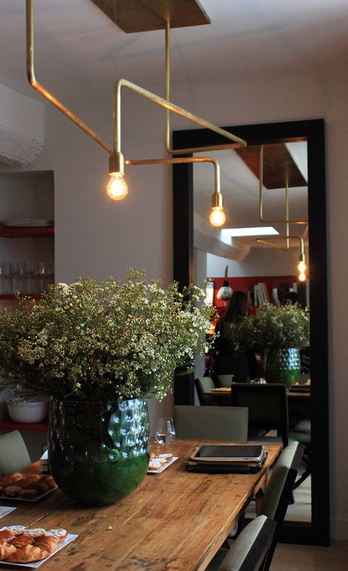 Brass lighting with foliage, beautiful combination. Interiors. Dining. Industrial. Indoor Plants. www.origin-of-style.com