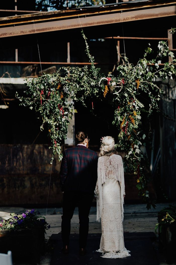 This Strongwater Columbus wedding features tons of stunning macramé details, a deep burgundy palette, and eclectic skull vibes.