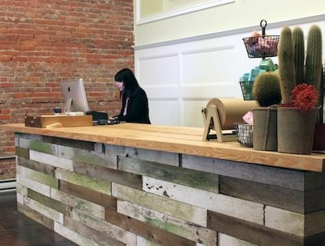 Reclaimed wood checkout counter at Old Faithful Shop. I am LOVING the roll of Kraft paper and its stand!