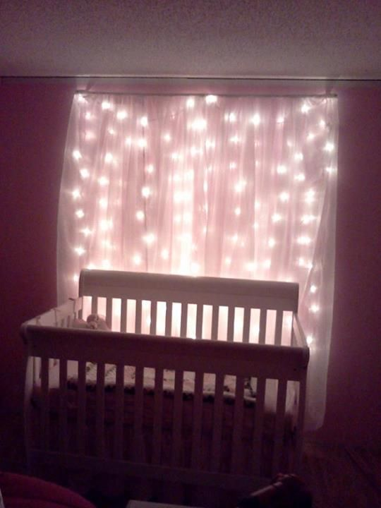 Snowfall Christmas Lights Behind Sheer Curtains Behind Crib As Night Lighting In