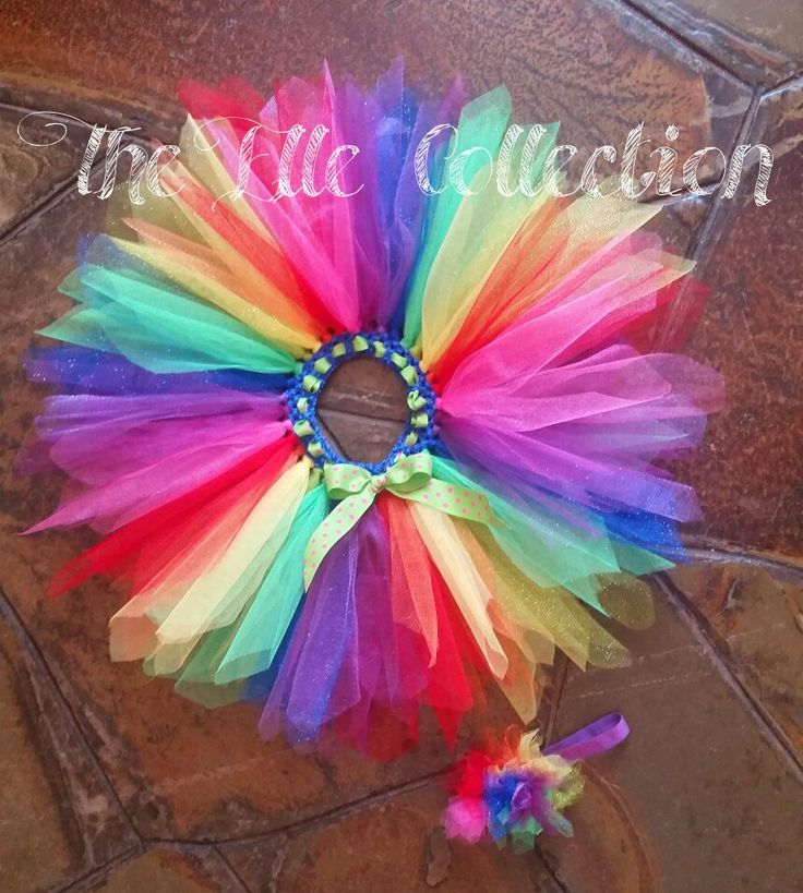 Bright rainbow tutu skirt and matching headband custom made by the Elle Collection in South Africa.  To order email Karin on theellecollection13@gmail.com