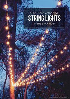 outdoor backyard lighting ideas. a canopy of string lights in our backyard outdoor lighting ideas t