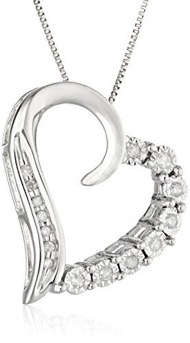 The 10k Gold Diamond Heart Pendant makes an ideal Valentine's or birthday gift for someone you admire and love. Made from rich 10k white gold, the heart pendant measures .78 inches high and .71 inches wide. The heart is cut in an asymmetrical design in which one half is lined with round white diamonds in four-prong settings. The other half features smooth gold accented with tiny matching diamonds at the bottom. The diamonds boast IJ color and I1-I2 clarity for a total of .1 carats. Hanging…