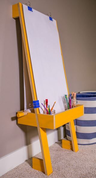 """Children's Art Easel: Creative kids deserve a creative place to pursue their artistic talents. This easel holds an 18""""-wide paper roll, which you can pick up at a craft store, plus a tray to hold crayons and other art supplies. The easel is designed to lean solidly against a wall at a height that's just right for kids. Find the FREE project plan, along with many others, at buildsomething.com"""