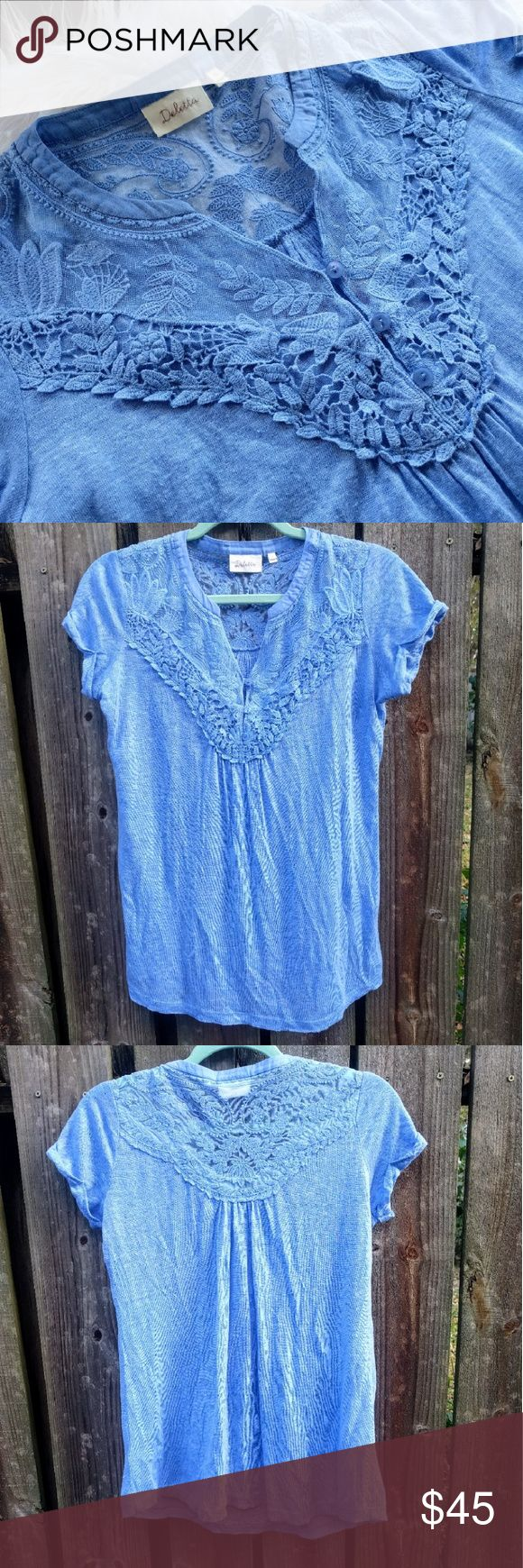 Deletta Periwinkle Embroidered Tee Features an embroidered front and back bodice, and button up front. The top of the back and front near the neck is a sheer tulle  material. The sleeves are rolled up by design and tacked down.   Top is in gently worn condition with no stains or holes. There seems to be some wear on the fabric, but that may be intentional & might've been like that new. See 4th pic.   Size XS, but it's loose enough to fit up to a Medium comfortably.  Armpit to armpit: abt…