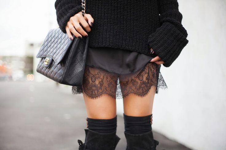 Thigh high boots, black lace skirt, and oversized black sweater