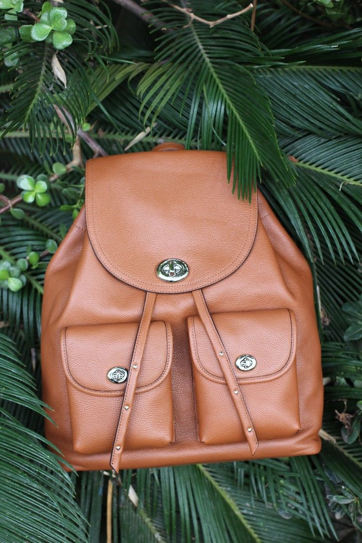 Loving the tiny turnlocks on this timeless Coach saddle brown backpack. #Ad