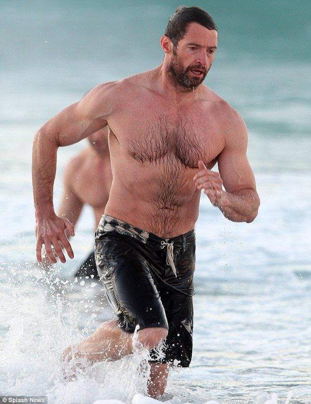 Man of Steel: Hugh Jackman showed off his super toned physique on Sunday while frolicking in the waters on Bondi Beach in Australia
