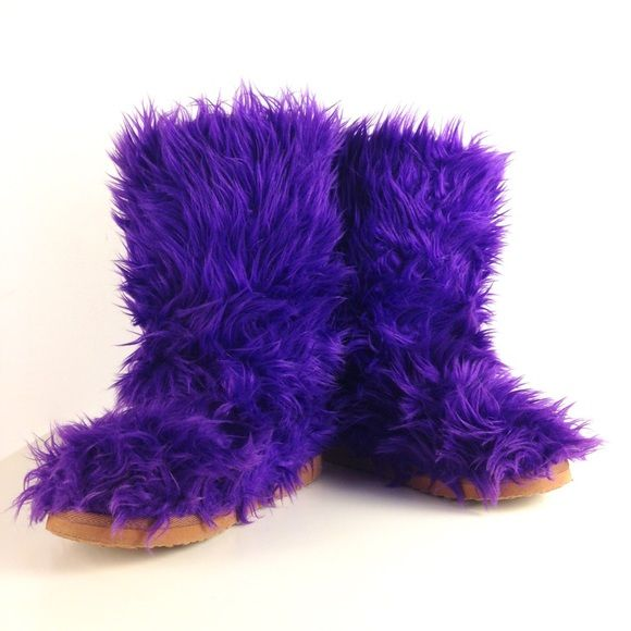 "Purple Furry Boots! Calling all cookie monsters!  Super cool lightweight pull-on furry boots in great condition. Lined in tan furry stuff. Sole is a strong foamy man made material. Very slight wear on the soles upon close inspection & a bit of wear on fur overall - just meaning they don't look brand new, but they look awesome! Total height 11"". Heel/sole height 3/4""-1"". Me want cookie!  Fluffy Wuffy Shoes Winter & Rain Boots"